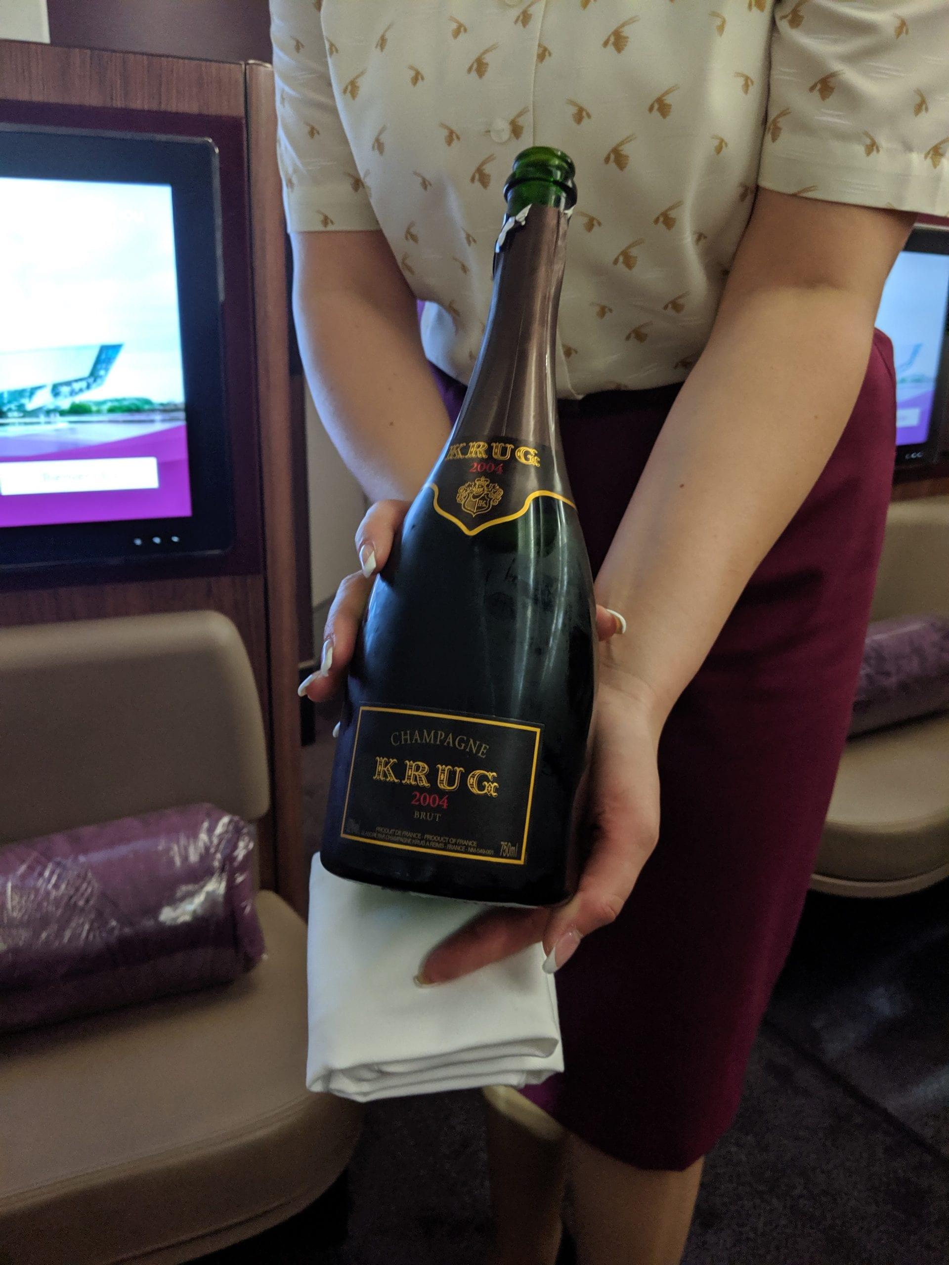 qatar airways first class champagne
