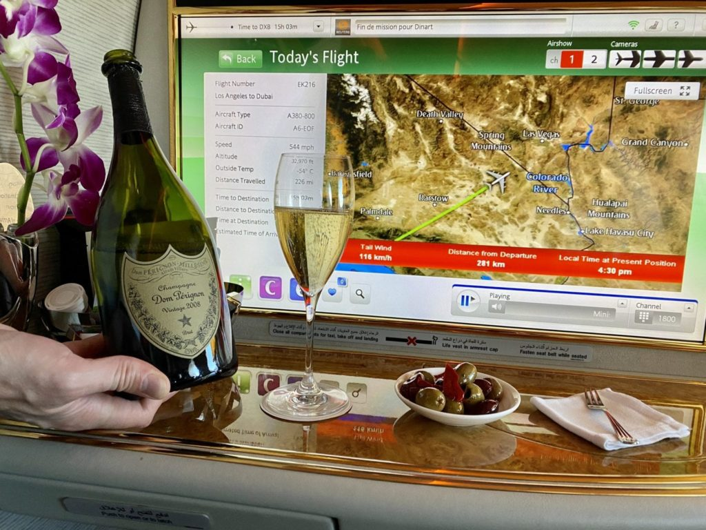 business Class vs First Class champagne