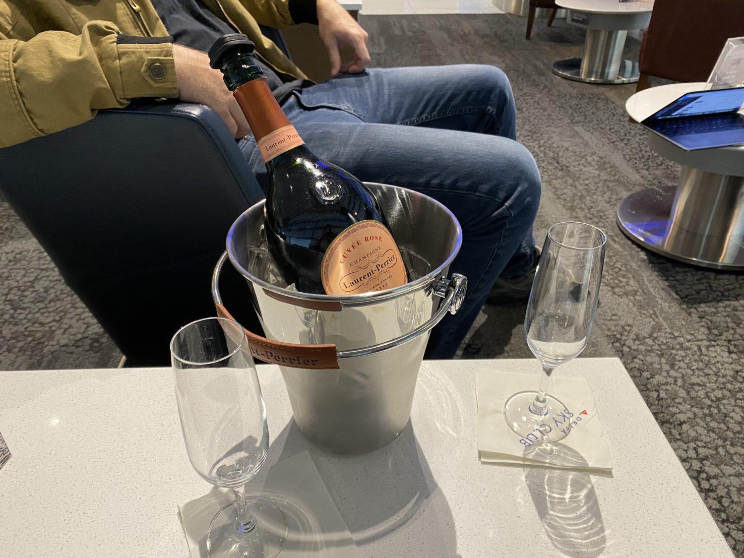 delta sky club champagne devaluation